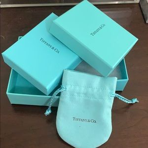 Two Tiffany boxes and one pouch